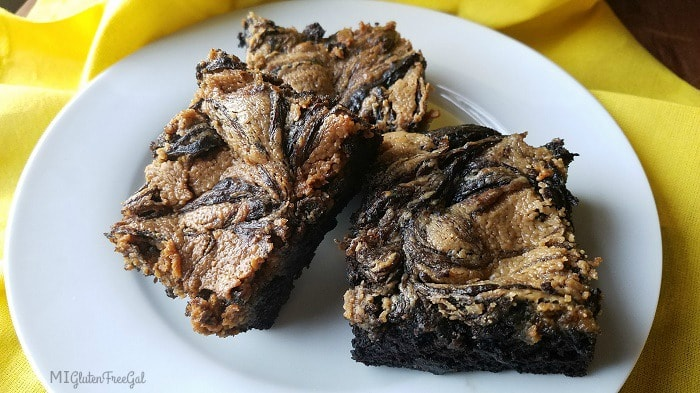 gluten-free Banana Flour Swirled Brownies on yellow linen