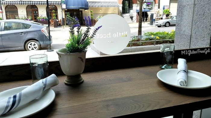 little beet table window seating with flowers